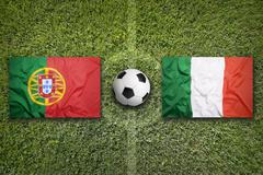 Portugal vs. Italy flags on soccer field - stock illustration