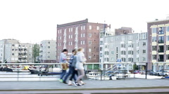 Commuter's view of city observed while crossing bridge over urban waterway Stock Footage