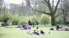 Enjoying sunny day in Sarphatipark in Amsterdam, Netherlands - stock footage