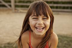 Portrait of laughing girl in farmyard Stock Photos