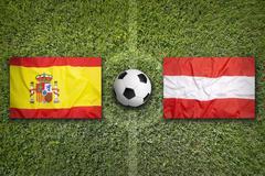 Spain vs. Austria flags on soccer field Stock Illustration