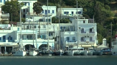 Yachts moored at quay on the background of houses of the Greek town Stock Footage