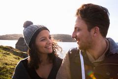 Couple by the coast, Connemara, Ireland Stock Photos