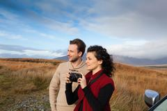 Couple sightseeing at countryside, Connemara, Ireland Stock Photos