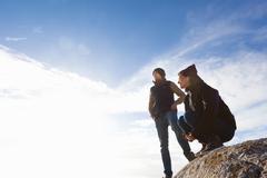 Couple on top of rock, Connemara, Ireland - stock photo