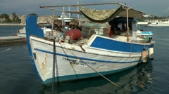 Traditional Greek fishing boat in the harbor - stock footage