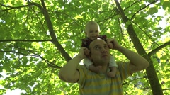 Father daughter in nature sunny park. parenthood and childhood. 4K Stock Footage