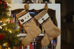 Stockings hanging on bookcase Stock Photos