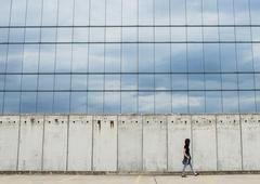Young woman walking by modern building Stock Photos
