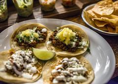 Mini tacos on plate - stock photo