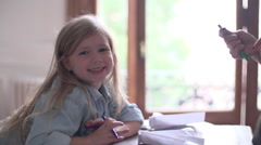 Little girl working on arts and crafts project at home Stock Footage