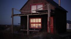 Rustic beach house at dusk Stock Footage