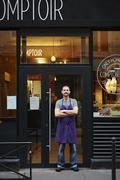 Portrait of restaurant owner, outside his business - stock photo