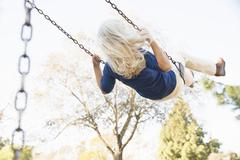 Senior woman playing swing, Hahn Park, Los Angeles, California, USA Stock Photos