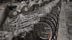 Bicycles parked in row at self-serve rental stall Stock Footage