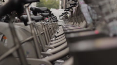 Bicycles parked at self-serve rental rack Stock Footage