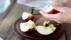 Slicing apple Stock Footage
