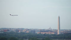 Washington DC cityscape and airplane flying Stock Footage