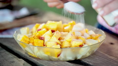 Sprinkling sugar onto fruit salad mixture Stock Footage
