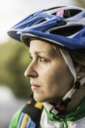 Close up portrait of young woman in cycling helmet, Augsburg, Bavaria, Germany Stock Photos