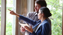 Couple talking and looking out of window Stock Footage