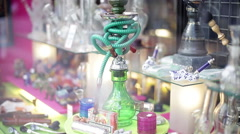 Hookah, pipes displayed in shop window Stock Footage