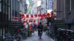 Alleyway lined with restaurants in Amsterdam, Netherlands Stock Footage
