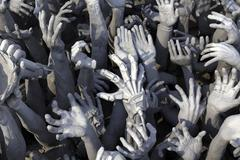 Hands leaning out of hell Stock Photos