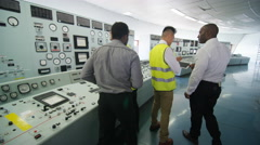 4K Mixed ethnicity team of engineers working in power station control room Stock Footage
