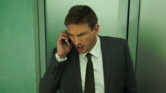Business man handing difficult phone call - stock footage