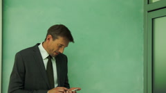 Businessman text messaging during break - stock footage