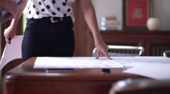 Woman discussing blueprints with a client Stock Footage