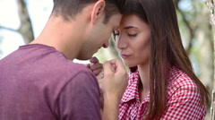 Young couple holding hands and touching foreheads with their eyes closed Stock Footage