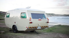 Travel trailer parked on beach - stock footage