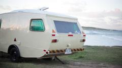 Travel trailer on beach Stock Footage