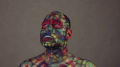 Colorful supervillain turning around Stock Footage