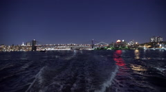 Boat point-of-view shot on the East River at night in New York City, New York Stock Footage