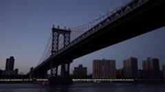 Drone shot moving under the Manhattan Bridge in New York City, New York, USA Stock Footage