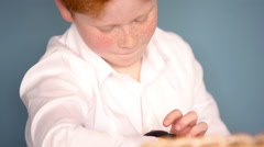 Boy using smartwatch - stock footage