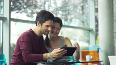 Couple using digital tablet at cafe Stock Footage