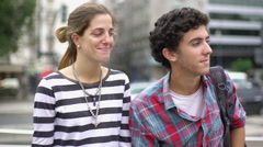 Couple waiting for bus Stock Footage