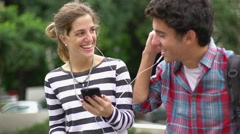 Couple listening to music together Stock Footage