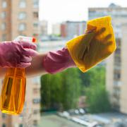 Washer cleans window glass with detergent Stock Photos