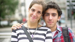 Couple looking at camera laughing Stock Footage