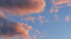 Time lapse clip of pink fluffy clouds over blue sky. Beautiful cloudscape on - stock footage