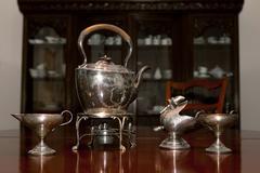 english teatime silverware in stylish interior - stock photo