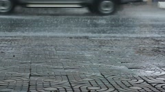 Rainy Day in Vietnam - Low Angle Shot Rain on Pavement Sidewalk of Street Stock Footage