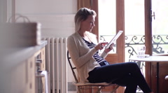 Woman using digital tablet at home Stock Footage