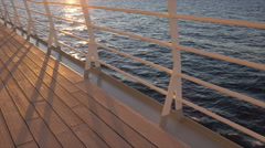 Cruise ship deck and railing at sunset, dolly shot Stock Footage
