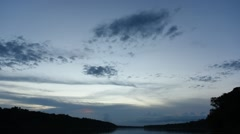 Dusk to night time lapse of clouds in sky over tranquil landscape Stock Footage